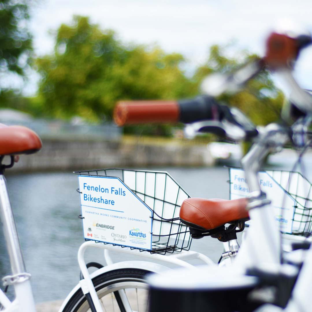 Image of bike handles and baskets, the Bike Share program.